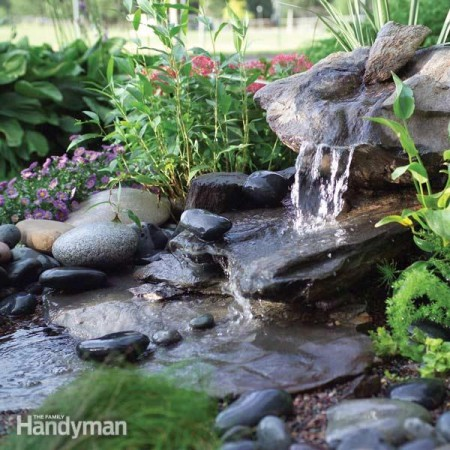 20 impressive diy water feature and garden pond ideas for Build a simple backyard waterfall